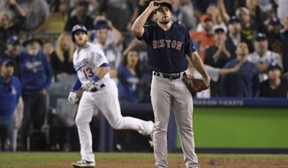 Los Angeles Dodgers' Max Muncy, left, watches his walk off home run off Boston Red Sox pitcher Nathan Eovaldi during the 18th inning in Game 3 of the World Series baseball game on Saturday, Oct. 27, 2018, in Los Angeles. (AP Photo/Mark J. Terrill)