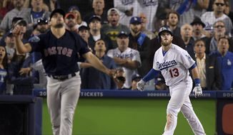 Los Angeles Dodgers' Max Muncy watches his walk off home run off Boston Red Sox pitcher Nathan Eovaldi during the 18th inning in Game 3 of the World Series baseball game on Saturday, Oct. 27, 2018, in Los Angeles. (AP Photo/Mark J. Terrill)