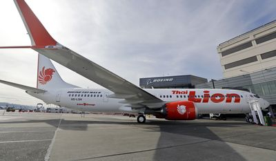 Boeing's first 737 MAX 9 jet is parked at the company's delivery center before a ceremony transferring ownership to Thai Lion Air, Wednesday, March 21, 2018, in Seattle. It is expected that the larger capacity airplane will help the airline launch several international routes. (AP Photo/Elaine Thompson)