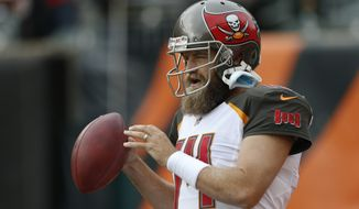 Tampa Bay Buccaneers quarterback Ryan Fitzpatrick (14) throws before an NFL football game against the Cincinnati Bengals in Cincinnati, Sunday, Oct. 28, 2018. (AP Photo/Gary Landers) ** FILE **