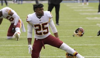 Washington Redskins running back Chris Thompson (25) warms up before an NFL football game against the New York Giants, Sunday, Oct. 28, 2018, in East Rutherford, N.J. (AP Photo/Bill Kostroun) ** FILE **