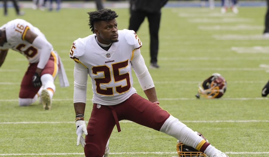 Washington Redskins running back Chris Thompson (25) warms up before an NFL football game against the New York Giants, Sunday, Oct. 28, 2018, in East Rutherford, N.J. (AP Photo/Bill Kostroun) **FILE**
