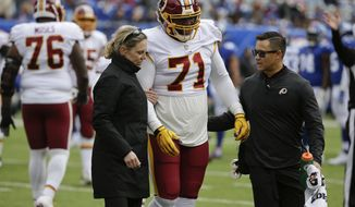 Washington Redskins offensive tackle Trent Williams (71) is helped off the field after an injury against the New York Giants during the second quarter of an NFL football game, Sunday, Oct. 28, 2018, in East Rutherford, N.J. (AP Photo/Seth Wenig) ** FILE **