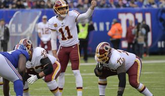 Washington Redskins quarterback Alex Smith (11) calls an audible at the line of scrimmage against the New York Giants during the first quarter of an NFL football game, Sunday, Oct. 28, 2018, in East Rutherford, N.J. (AP Photo/Bill Kostroun)