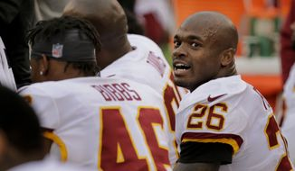 Washington Redskins running back Adrian Peterson (26) reacts after scoring a touchdown against the New York Giants during the fourth quarter of an NFL football game, Sunday, Oct. 28, 2018, in East Rutherford, N.J. (AP Photo/Seth Wenig)