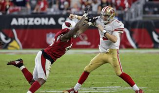 San Francisco 49ers quarterback C.J. Beathard (3) throws under pressure from Arizona Cardinals linebacker Haason Reddick during the second half of an NFL football game, Sunday, Oct. 28, 2018, in Glendale, Ariz. The Cardinals won 18-15. (AP Photo/Rick Scuteri)