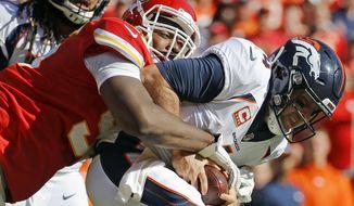 Kansas City Chiefs defensive lineman Chris Jones (95) sacks Denver Broncos quarterback Case Keenum (4) during the second half of an NFL football game in Kansas City, Mo., Sunday, Oct. 28, 2018. (AP Photo/Charlie Riedel)