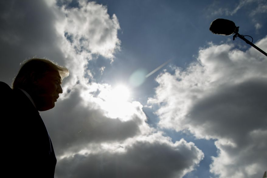 President Donald Trump speaks to reporters about a shooting at a Pittsburgh synagogue at Indianapolis International Airport in Indianapolis, Saturday, Oct. 27, 2018, to speak at the 91st Annual Future Farmers of America Convention and Expo. (AP Photo/Andrew Harnik)