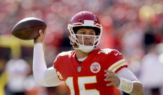 Kansas City Chiefs quarterback Patrick Mahomes looks to throw a pass during the first half of an NFL football game against the Denver Broncos in Kansas City, Mo., Sunday, Oct. 28, 2018. (AP Photo/Orlin Wagner)