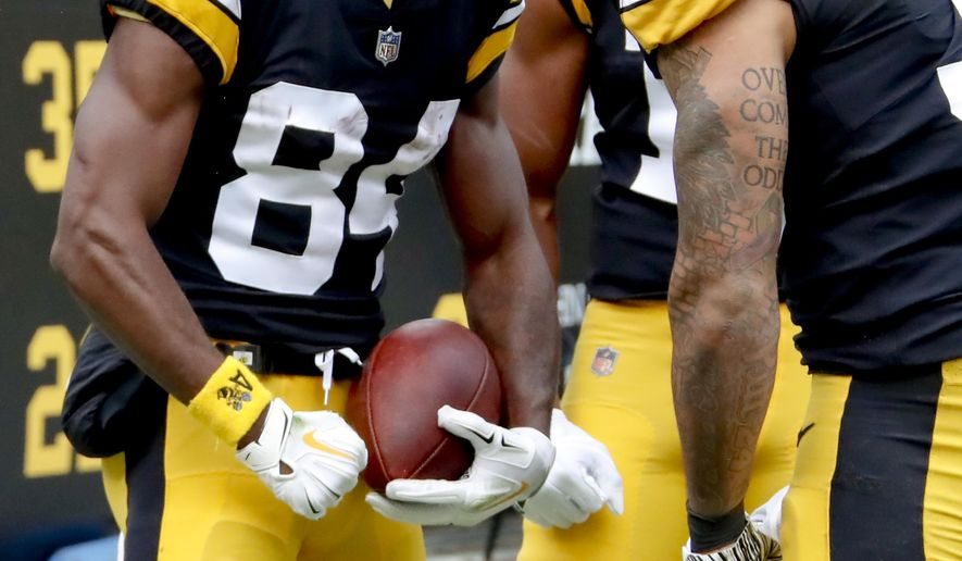 Pittsburgh Steelers wide receiver Antonio Brown (84) celebrates with running back James Conner (30) after catching a pass for a touchdown against the Cleveland Browns in the second quarter of an NFL football game, Sunday, Oct. 28, 2018, in Pittsburgh. (AP Photo/Gene J. Puskar)