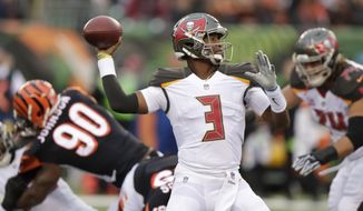 Tampa Bay Buccaneers quarterback Jameis Winston (3) prepares to throw against the Cincinnati Bengals during the first half of an NFL football game in Cincinnati, Sunday, Oct. 28, 2018. (AP Photo/Michael Conroy)