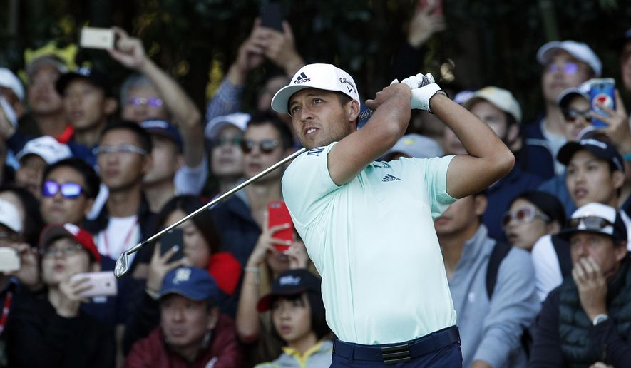 Xander Schauffele of the United States tees off during the HSBC Champions golf tournament held at the Sheshan International Golf Club in Shanghai, Sunday, Oct. 28, 2018. (AP Photo/Ng Han Guan)