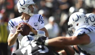 Indianapolis Colts quarterback Andrew Luck passes against the Oakland Raiders during the first half of an NFL football game in Oakland, Calif., Sunday, Oct. 28, 2018. (AP Photo/Ben Margot)