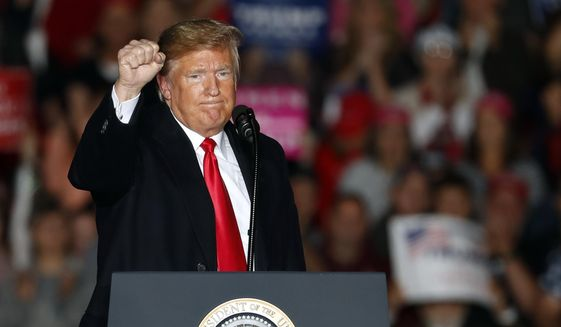 President Donald Trump pumps his fist as he leaves the stage after speaking to supporters during a rally at Southern Illinois Airport Saturday, Oct. 27, 2018, in Murphysboro, Ill. (AP Photo/Jeff Roberson)