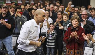 New Jersey Democratic Sen. Cory Booker exits the stage after speaking at a get out the vote event hosted by the NH Young Democrats  at the University of New Hampshire in Durham, N.H. Sunday, Oct. 28, 2018. (AP Photo/ Cheryl Senter)