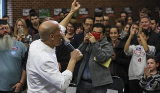 New Jersey Democratic Sen. Cory Booker speaks at a get out the vote event hosted by the NH Young Democrats at the University of New Hampshire in Durham, N.H. Sunday, Oct. 28, 2018. (AP Photo/Cheryl Senter)