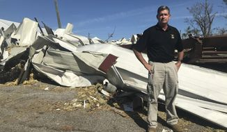 In this Oct. 24, 2018 photo, Panama City manager Mark McQueen poses for a photo near an area destroyed by Hurricane Michael in Panama City, Fla. The retired two- star general, started his new job two weeks before the storm. (AP Photo/Tamara Lush)