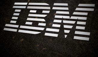 FILE - In this April 26, 2017, file photo, the IBM logo is displayed on the IBM building in Midtown Manhattan, in New York. IBM announced Sunday, Oct. 28, 2018, it will acquire North Carolina-based open-source software company Red Hat in a $34 billion stock deal that the technology and consulting giant's chief executive says will advance the company to the next step in cloud computing. (AP Photo/Mary Altaffer, File)
