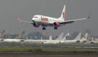 In this May 12, 2012, file photo, a Lion Air passenger jet takes off from Juanda International Airport in Surabaya, Indonesia. Indonesia's Lion Air said Monday, Oct. 29, 2018, it has lost contact with a passenger jet flying from Jakarta to an island off Sumatra. (AP Photo/Trisnadi, File)