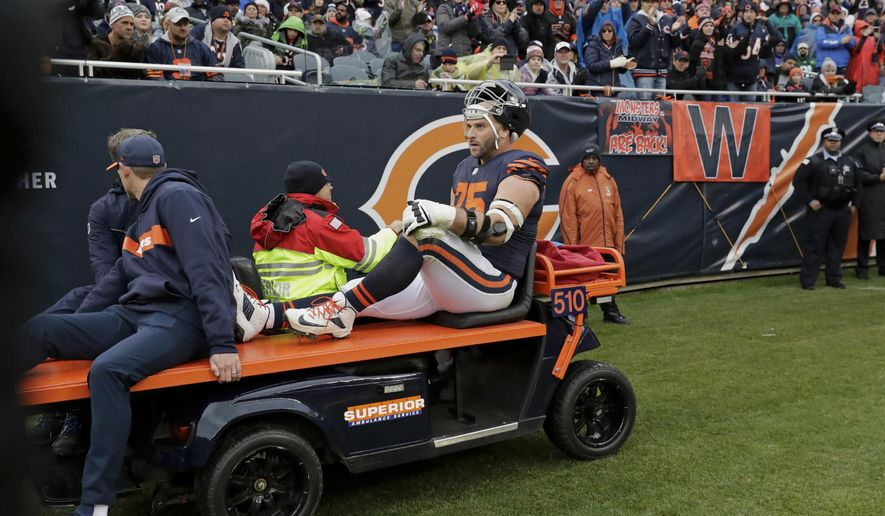 Chicago Bears offensive guard Kyle Long (75) is taken by cart off the field after an injury in the second half of an NFL football game against the New York Jets Sunday, Oct. 28, 2018, in Chicago. (AP Photo/Nam Y. Huh)