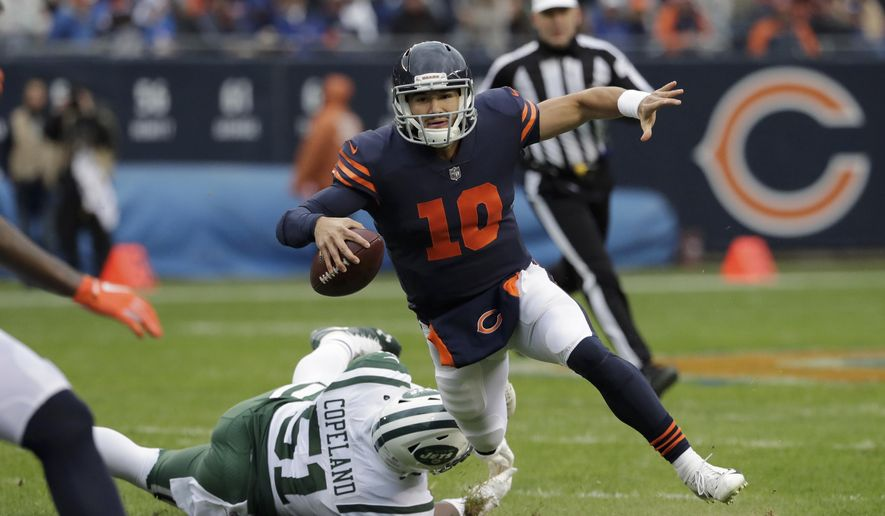 Chicago Bears quarterback Mitchell Trubisky (10) is tripped by New York Jets outside linebacker Brandon Copeland (51) during the first half of an NFL football game Sunday, Oct. 28, 2018, in Chicago. (AP Photo/Nam Y. Huh)