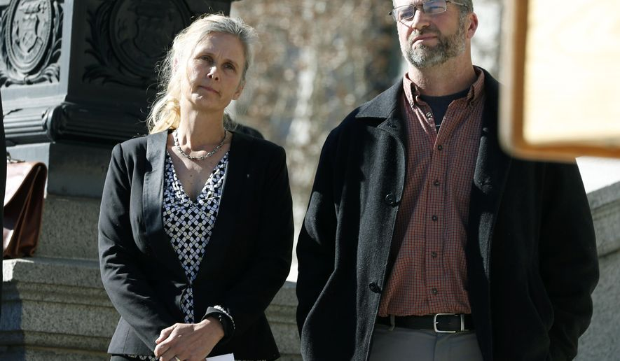 FILE - In this Feb. 19, 2015 file photo Hope, left, and Mike Reilly of Pueblo, Colo., attend a news conference in reaction to the announcement that a federal lawsuit is being filed on behalf of the couple by a Washington D.C.-based group to shut down the state's $800-million-a-year marijuana industry, in Denver. A federal trial in Colorado on Monday, Oct. 29, 2018, could have far-reaching effects on the budding U.S. marijuana industry if a jury sides with the couple who say having a cannabis business as a neighbor hurts their property's value. (AP Photo/David Zalubowski, File)