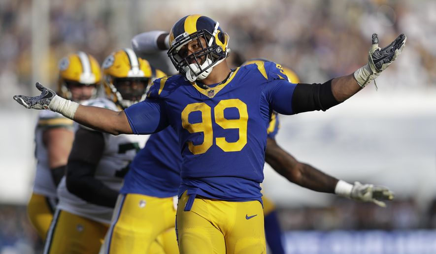 Los Angeles Rams defensive tackle Aaron Donald reacts after sacking Green Bay Packers quarterback Aaron Rodgers during the second half of an NFL football game, Sunday, Oct. 28, 2018, in Los Angeles. (AP Photo/Marcio Jose Sanchez)