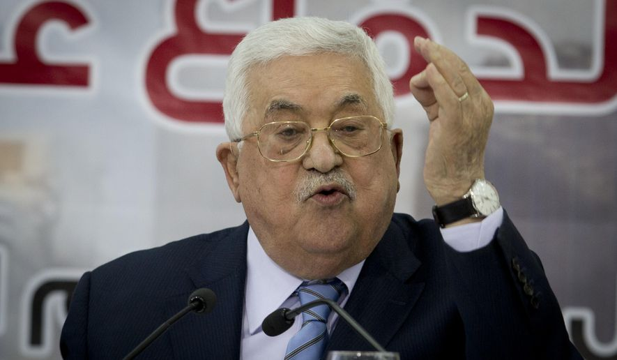 Palestinian President Mahmoud Abbas speaks during a meeting of the Central Council of the Palestinian Liberation Organization in the West Bank city of Ramallah, Sunday, Oct. 28, 2018. Abbas is accused his Hamas rivals of serving U.S. interests by refusing to relinquish control of the Gaza Strip to him. Abbas has said he fears that the U.S. is planning a proposal that would offer the Palestinians limited statehood in the Hamas-controlled Gaza Strip and some autonomy in parts of the Israeli-occupied West Bank. (AP Photo/Majdi Mohammed)