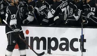 Los Angeles Kings defenseman Alec Martinez (27) celebrates scoring with teammates on the bench during last minute of the third period of an NHL hockey game against the New York Rangers in Los Angeles, Sunday, Oct. 28, 2018. The Kings won 4-3. (AP Photo/Alex Gallardo)
