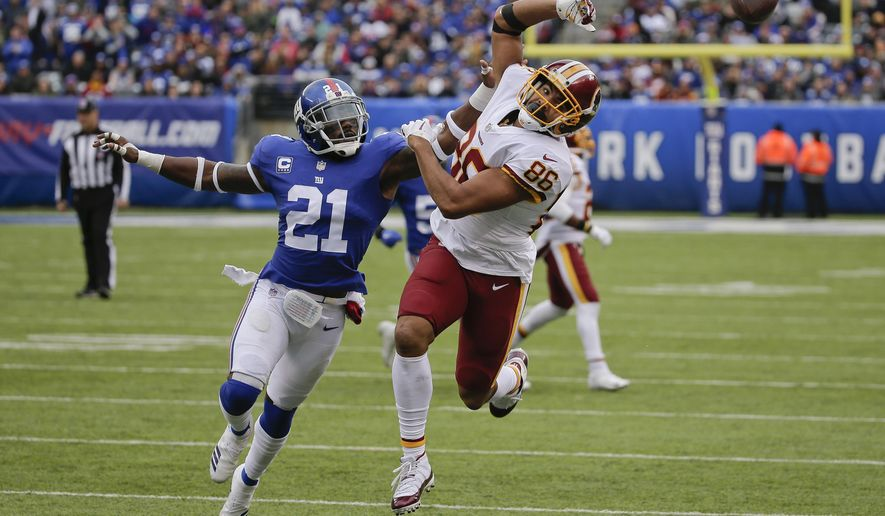 New York Giants strong safety Landon Collins (21) breaks up a pass intended for Washington Redskins tight end Jordan Reed (86) during the third quarter of an NFL football game, Sunday, Oct. 28, 2018, in East Rutherford, N.J. (AP Photo/Seth Wenig)