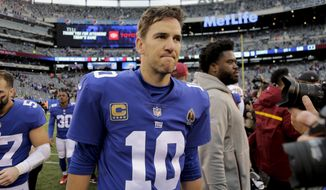 New York Giants quarterback Eli Manning (10) walks off the field after the Washington Redskins beat the Giants 20-13 in an NFL football game, Sunday, Oct. 28, 2018, in East Rutherford, N.J. (AP Photo/Seth Wenig)