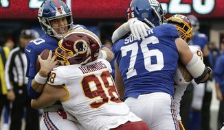 New York Giants quarterback Eli Manning (10) is sacked by Washington Redskins defensive tackle Matthew Ioannidis (98) during the second quarter of an NFL football game, Sunday, Oct. 28, 2018, in East Rutherford, N.J. (AP Photo/Seth Wenig)