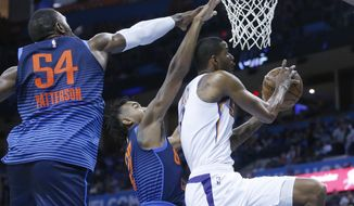 Phoenix Suns forward Trevor Ariza (3) goes to the basket in front of Oklahoma City Thunder forward Patrick Patterson (54) and guard Terrance Ferguson (23) in the first half of an NBA basketball game in Oklahoma City, Sunday, Oct. 28, 2018. (AP Photo/Sue Ogrocki)
