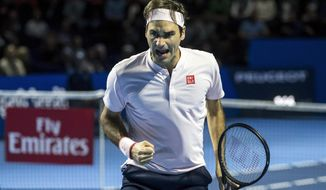 Switzerland's Roger Federer reacts during his final match against Romania's Marius Copil at the Swiss Indoors tennis tournament at the St. Jakobshalle in Basel, Switzerland, on Sunday, Oct. 28, 2018. (Alexandra Wey/Keystone via AP)
