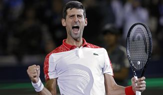 FILE  - In this Sunday, Oct. 14, 2018 file photo, Novak Djokovic of Serbia celebrates after defeating Borna Coric of Croatia in their men's singles final match in the Shanghai Masters tennis tournament at Qizhong Forest Sports City Tennis Center in Shanghai, China. Djokovic is in electric form heading into the Paris Masters, where he is well poised to wrestle back the No. 1-ranking from longtime rival Rafael Nadal. (AP Photo/Andy Wong, File)