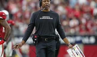 Arizona Cardinals head coach Steve Wilks makes a call during the second half of an NFL football game against the San Francisco 49ers, Sunday, Oct. 28, 2018, in Glendale, Ariz. (AP Photo/Ralph Freso)