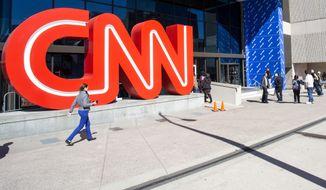 People walk outside CNN Center, Wednesday, Oct. 24, 2018, in Atlanta. (AP Photo/Ron Harris) ** FILE **