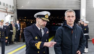 Commander of Standing NATO Maritime Group One, Anders Friis, left, talks with NATO Secretary General Jens Stoltenberg, on the Danish support ship HDMS Esbern Snare during his visit to the NATO exercise, in Trondheim, Norway, Monday Oct. 29. 2018. (Gorm Kallestad / NTB scanpix via AP)