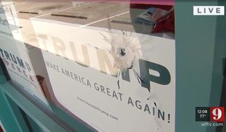"""At least four shots were reportedly fired into the Volusia County Republican Party headquarters in Florida overnight Sunday, shattering a front window and piercing a """"Trump: Make America Great Again"""" sign. (WFTV)"""