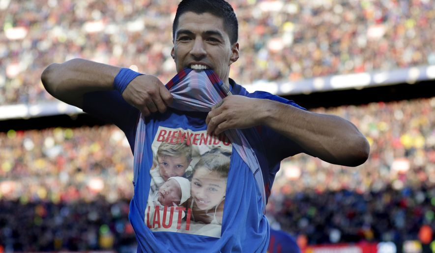 Barcelona forward Luis Suarez celebrates scoring his side's second goal during the Spanish La Liga soccer match between FC Barcelona and Real Madrid at the Camp Nou stadium in Barcelona, Spain, Sunday, Oct. 28, 2018. (AP Photo/Manu Fernandez)