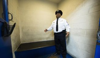 In this Friday, Oct. 26, 2018, file photo, Philadelphia Police Sgt. John Ross discusses the Police 9th District's juvenile holding cell in Philadelphia.  (AP Photo/Matt Rourke) **FILE**