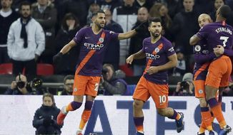 Manchester City's Riyad Mahrez, left, celebrates after scoring the opening goal during the English Premier League soccer match between Tottenham Hotspur and Manchester City at Wembley stadium in London, England, Monday, Oct. 29, 2018. (AP Photo/Tim Ireland)