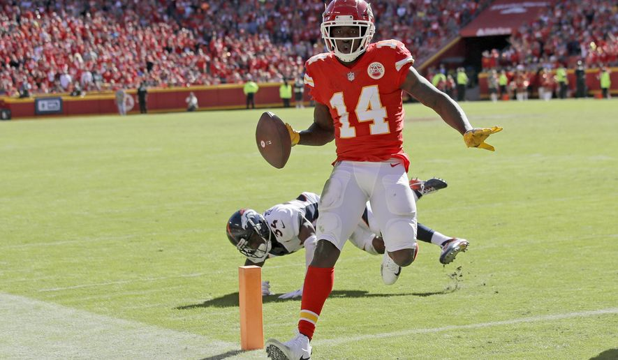 Kansas City Chiefs wide receiver Sammy Watkins (14) scores a touchdown in front of Denver Broncos safety Will Parks (34) during the second half of an NFL football game in Kansas City, Mo., Sunday, Oct. 28, 2018. (AP Photo/Orlin Wagner)