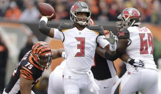 Tampa Bay Buccaneers quarterback Jameis Winston (3) looks to throw against the Cincinnati Bengals during the first half of an NFL football game in Cincinnati, Sunday, Oct. 28, 2018. (AP Photo/Michael Conroy)
