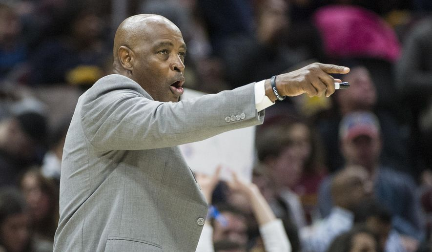 """FILE - In this April 1, 2018 file photo, Cleveland Cavaliers interim coach Larry Drew gestures to his team during the second half of an NBA basketball game against the Dallas Mavericks in Cleveland. The Cavaliers have a coach for Tuesday night, Oct. 30. Top assistant Drew, who was expected to take over after Cleveland fired Tyronn Lue, said Monday, Oct. 29 that he is not the team's interim coach but is merely """"the voice right now."""" Drew said his agent Andy Miller has been in talks with the Cavs about restructuring his contact and is not making any long-term commitment to the team until they reach an agreement. Lue was fired on Sunday, Oct. 28 by general manager Koby (AP Photo/Phil Long, File)"""