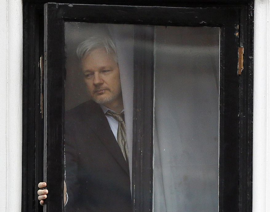 In this Feb. 5, 2016 file photo, Wikileaks founder Julian Assange walks onto the balcony of the Ecuadorean Embassy in London. (AP Photo/Kirsty Wigglesworth, File)