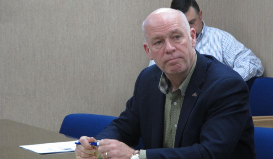 In this Tuesday, Oct. 9, 2018 photo Rep. Greg Gianforte listens during a meeting with leaders from the Montana Department of Justice and Montana Highway Patrol in Helena, Mont.. Gianforte is running against Democratic challenger Kathleen Williams to keep the congressional seat he won last year in a special election. (AP Photo/Matt Volz)