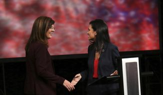 State Rep. Mandy Powers Norrell, D-Lancaster, right, and Republican Upstate businesswoman Pamela Evette give their opening statements during the lieutenant governor's debate at South Carolina ETV studios in Columbia, S.C., Monday, Oct. 29, 2018. The women seeking to become South Carolina's next lieutenant governor met in their only debate Monday, giving voters a chance to compare the ways in which they envision leading the newly-redesigned office. (Gavin Jackson/SCETV via AP, Pool)