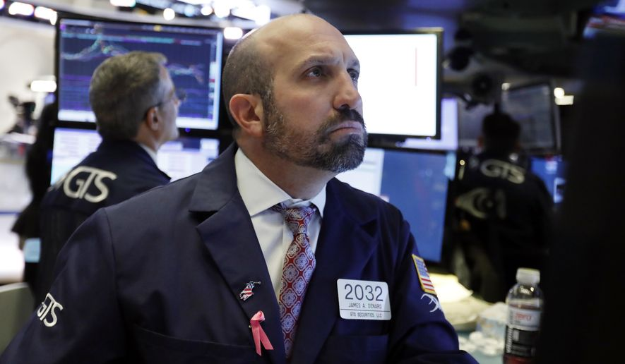FILE- In this Oct. 23, 2018, file photo specialist James Denaro works on the floor of the New York Stock Exchange. The U.S. stock market opens at 9:30 a.m. EDT on Monday, Oct. 29. (AP Photo/Richard Drew)