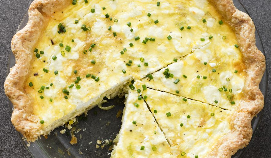"""This undated photo provided by America's Test Kitchen in October 2018 shows a leek and goat cheese quiche in Brookline, Mass. This recipe appears in the cookbook """"ATB Brunch."""" (Daniel J. van Ackere/America's Test Kitchen via AP)"""
